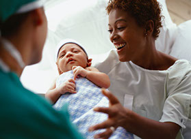 image of mom and doctor with baby